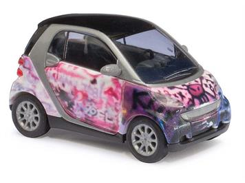"""Busch Smart Fortwo 07 Puzzle """"Pink skull"""" (BJ 2007) HO"""