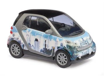 "Busch Smart Fortwo 07 Puzzle ""skyline"" (BJ 2007) HO"